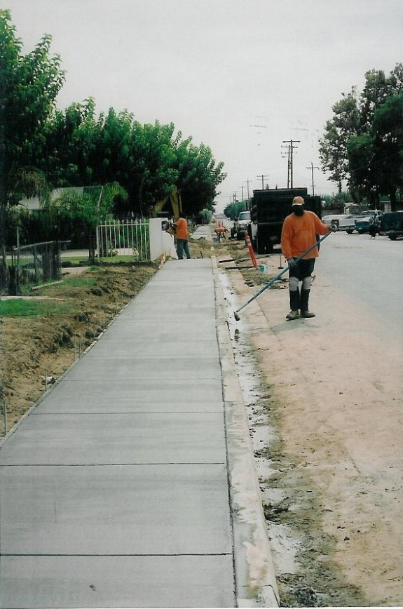 The new sidewalks provided safe walking space for residents, and significantly decreased street flooding.